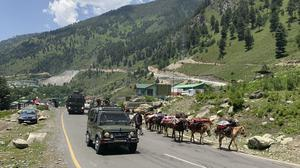 """An Indian army convoy moves on the Srinagar- Ladakh highway at Gagangeer, north-east of Srinagar, Indian controlled Kashmir, Thursday, June 18, 2020. India on Thursday cautioned China against making """"exaggerated and untenable claims"""" to the Galwan Valley area even as both nations tried to end a standoff in the Himalayan region where their armies engaged in a deadly clash. Twenty Indian troops were killed in Monday's clash, which was the deadliest conflict between the sides in 45 years. China has not disclosed whether its forces suffered any casualties. (AP Photo)"""
