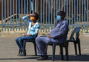 People wearing face masks to protect against coronavirus (Themba Hadebe/AP)