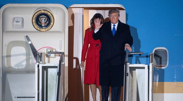 US President Donald Trump and his wife Melania, arrive at Stansted Airport ahead of the NATO summit (Joe Giddens/PA)