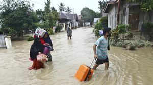 A number of people were killed and missing after heavy rains in the South Sulawesi province (Khaizuran Muchtamir/AP)