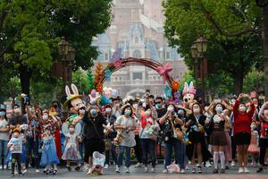 Tourists visit Shanghai Disneyland after its reopening yesterday