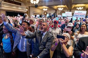 Supporters react as President Donald Trump speaks at the Latinos for Trump round table at a Phoenix Resort (Andrew Harnik/AP)