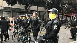 Seattle police block a street with their bikes in the Capitol Hill Organised Protest zone (Chop) Aron Ranen/AP)