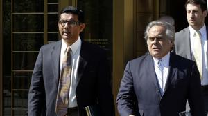 Dinesh D'Souza, left, accompanied by his lawyer Benjamin Brafman, leaves federal court, in New York (Richard Drew/AP)