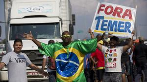 Striking lorry drivers protest against rising fuel costs in Duque de Caxias, Brazil (Silvia Izquierdo/AP)