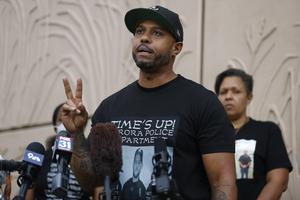 Terrence Roberts talks at a memorial site across the street from where Elijah McClain was stopped by police (David Zalubowski/AP)