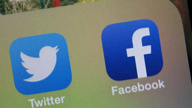 Facebook and Twitter icons (Chris Ison/PA)
