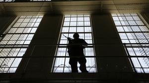 A guard stands watch over the east block of death row at San Quentin State Prison in California (Eric Risberg/AP)