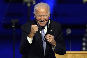 President-elect Joe Biden gestures to supporters at his victory speech on Saturday (Andrew Harnik/AP)