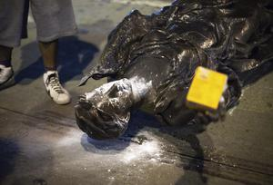 Wisconsin's Forward statue lies in the street on Capitol Square in Madison (Emily Hamer/Wisconsin State Journal via AP)