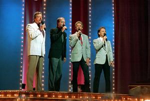 The Statler Brothers, from left, Harold Reid, Don Reid, Phil Balsley and Jimmy Fortune, perform at the 23rd annual Music City News Country Awards show in Nashville, Tennessee, in 1989 (Mark Humphrey/AP)