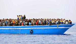 Migrants stranded on a boat, 30 miles off the Libyan coast as they are rescued by Royal Marines (Rowan Griffiths/Daily Mirror/PA)