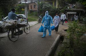 A health worker during a door-to-door drive to test for Covid-19 in Gauhati, India (Anupam Nath/AP)