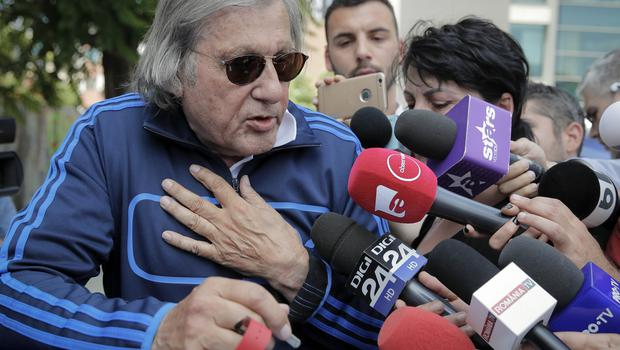 Ilie Nastase speaks to the media outside the traffic police headquarters in Bucharest
