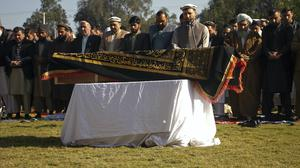 Afghans pray for TV presenter Malala Maiwand during her funeral ceremony in Jalalabad (AP)