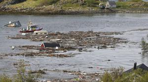 Flotsam and debris fills the bay after a landslide near Alta, Arctic Norway (Hanne Larsen/AP)