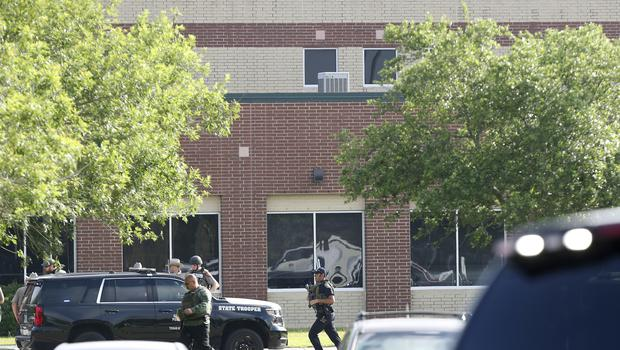Law enforcement officers respond to Santa Fe High School after an active shooter was reported on campus (Steve Gonzales/AP)