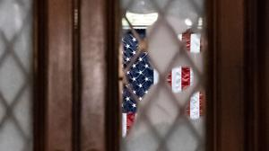 Broken glass from last week's confrontation with a pro-Trump mob is seen in the door to the House chamber at the Capitol (J. Scott Applewhite/AP)