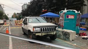 A car in seen in the Capitol Hill Organised Protest zone in Seattle (Aron Ronen/AP)