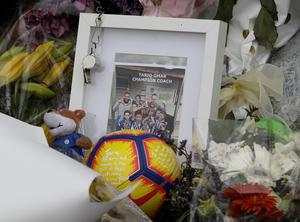 A tribute for mosque shooting victim Tariq Omar is placed at the Botanical Gardens in Christchurch (Mark Baker/AP)