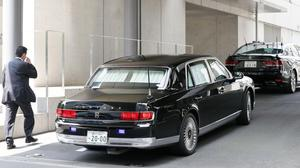 A car, left, carrying Japanese prime minister Shinzo Abe, arrives at Keio University Hospital in Tokyo (AP)
