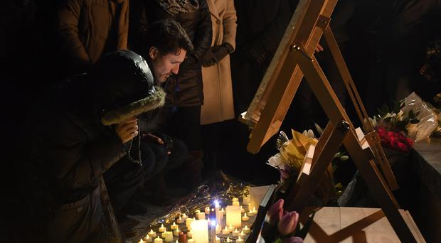Justin Trudeau attends a vigil for the plane crash victims (Adrian Wyld/The Canadian Press via AP)
