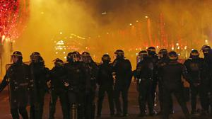 Riot police on the Champs Elysees (AP Photo//Michel Euler)