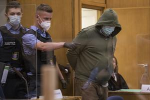 Markus H is led into the courtroom (Thomas Lohnes/AP)