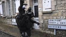 French police carry out searches in Corcy, northern France, as part of an investigation into Wednesday's attack