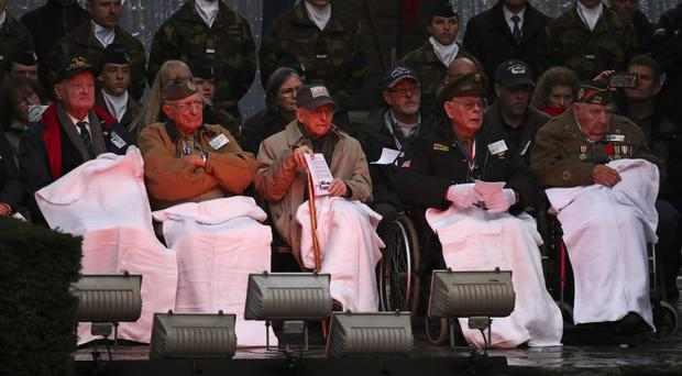 US veterans of the Battle of the Bulge listen to speeches during a ceremony to commemorate the 75th anniversary (Francisco Seco/AP)