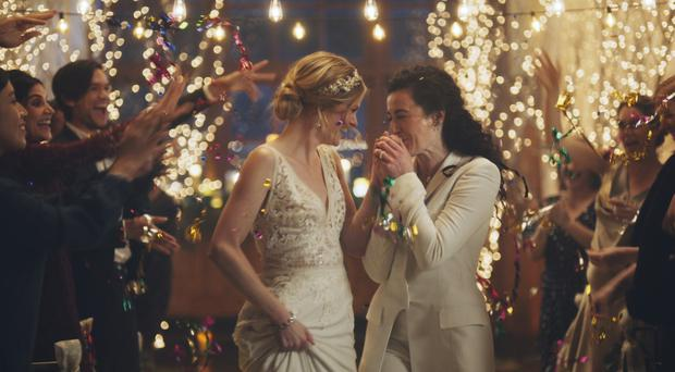 The Hallmark Channel has pulled the ads for wedding-planning website Zola (Zola/AP)
