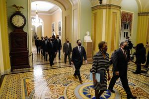 Clerk of the House Cheryl Johnson along with acting House Sergeant-at-Arms Tim Blodgett lead the Democratic House impeachment managers to deliver to the Senate the article of impeachment (Melina Mara/The Washington Post via AP, Pool)