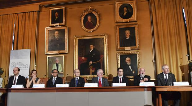 From left, economic sciences laureates Michael Kremer, Esther Duflo and Abhijit Banerjee, chemistry laureates Akira Yoshino and Stanley Whittingham, and physics laureates Didier Queloz, Michel Mayor and James Peebles (Jonas Ekstromer/TT News Agency/AP)