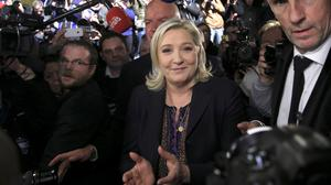 Marine Le Pen posted the images in response to a journalist who made an analogy between her National Front party and Islamic State (AP)