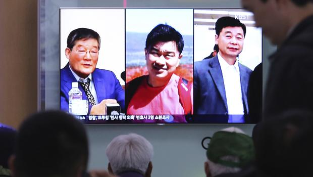 Tony Kim - pictured in the centre - was freed along with two other American citizens (Ahn Young-joon/AP)
