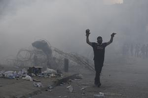 Protesters clashed with police (Hassan Ammar/AP)