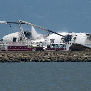 A fire engine sprays water on Asiana Flight 214 after it crashed at San Francisco International Airport (AP/Noah Berger)