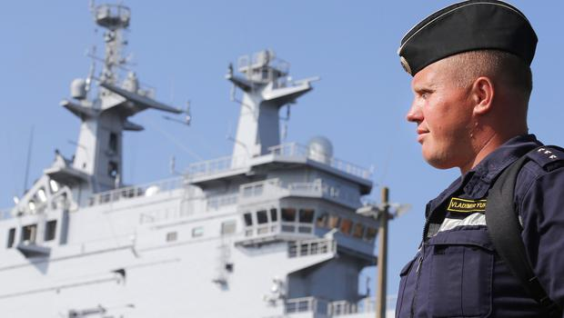 A Russian sailor and the Vladivostok warship near the port of Saint-Nazaire. (AP)