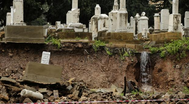 Graves in a Jewish cemetery collapsed from heavy rain in the Sodeco area of Beirut, Lebanon (Hassan Ammar/AP)