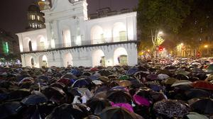 Protesters march in heavy rain in Buenos Aires (AP)