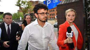Arsalan Tariq Khawaja, center, is seen at Parramatta Police Station in Sydney, Tuesday, Dec. 4, 2018. The Australian international cricketer Usman Khawaja's older brother was jailed on Thursday, Nov. 5, 2020, after being sentenced for his actions in framing a colleague using a fake terror plot. (Brendan Esposito/AAP Image via AP)