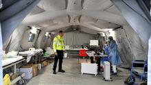 Paramedics work in a tent that was set up outside the hospital of Cremona (Claudio Furlan/AP)