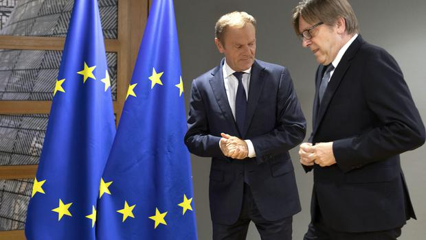 European Council president Donald Tusk, left, with Renew Europe party member Guy Verhofstadt (Virginia Mayo/AP)