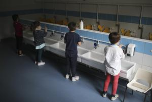 Children wash their hands at a primary school in France (Daniel Cole/AP)