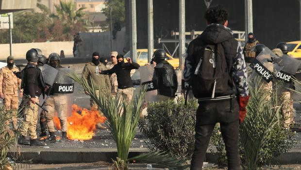 Security forces try to disperse anti-government protesters during clashes in central Baghdad, Iraq, Monday, Jan. 20, 2020. Iraqi security forces also used live rounds, wounding over a dozen protesters, medical and security officials said, in continuing violence as anti-government demonstrators make a push to revive their movement in Baghdad and the southern provinces. (AP Photo/Hadi Mizban)