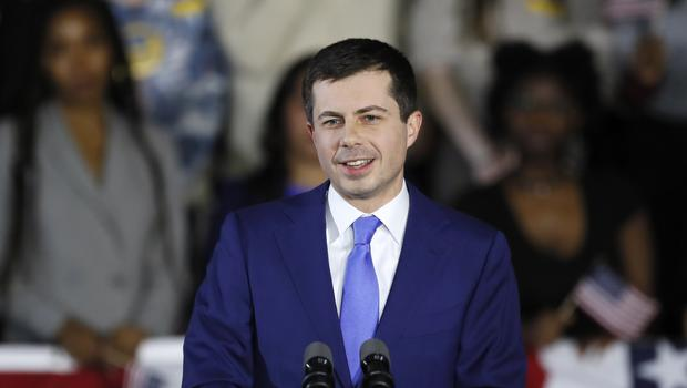 Democratic presidential candidate Pete Buttigieg speaks to supporters at a caucus night campaign rally (Charlie Neibergall/AP)