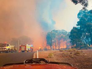 An out-of-control wildfire is burning north-east of the Australian west coast city of Perth (Greg Bell/DFES via AP)