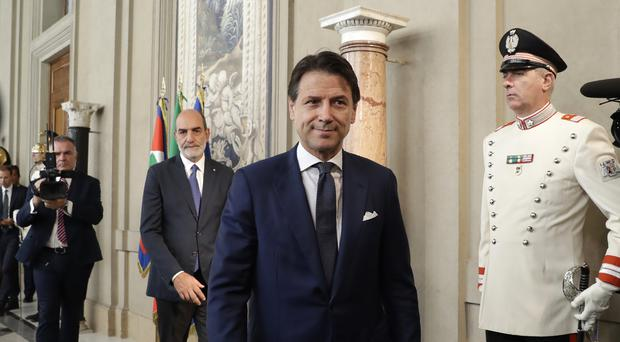 Italy's president has given the recently resigned premier, Giuseppe Conte, a fresh mandate to see if he can form a new government (Andrew Medichini/AP)