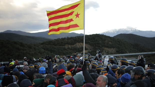 French police officers remove pro-Catalan independence demonstrators (AP Photo/Joan Mateu)