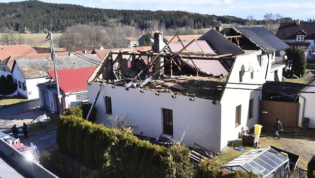 The roof of a house is damaged due to a strong storm in Rohozna, Czech Republic (Lubos Pavlicek/CTK via AP)